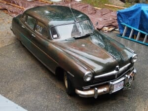 1949 Hudson parked amongst building materials of her host.